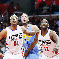 24 February 2016: Denver Nuggets center Joffrey Lauvergne (77) vies for the rebound with Los Angeles Clippers forward Paul Pierce (34) and Los Angeles Clippers forward Luc Richard Mbah a Moute (12) during the Denver Nuggets 87-81 victory over the Los Angeles Clippers, at the Staples Center, Los Angeles, California, USA.