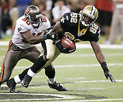 NEW ORLEANS - OCTOBER 10:  Tight end Boo Williams #82 of the New Orleans Saints gains some yards after a catch against linebacker Jeff Gooch #50 of the Tampa Bay Buccaneers at the Louisiana Superdome on October 10, 2004 in New Orleans, Louisiana. The Bucs defeated the Saints 20-17. ©Paul Anthony Spinelli *** Local Caption *** Boo Williams, Jeff Gooch