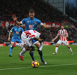 Bojan Krkic of Stoke City (L) is fouled in the area by Simon Francis of Bournemouth conceding a openalty- Mandatory by-line: Jack Phillips/JMP - 19/11/2016 - FOOTBALL - Bet365 Stadium - Stoke-on-Trent, England - Stoke City v Bournemouth - Premier League