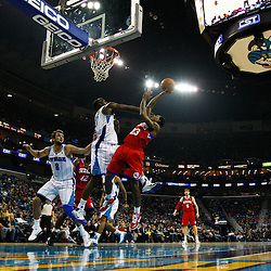 January 3, 2011; New Orleans, LA, USA; Philadelphia 76ers point guard Lou Williams (23) shoots over New Orleans Hornets center Emeka Okafor (50) during the first quarter at the New Orleans Arena.   Mandatory Credit: Derick E. Hingle