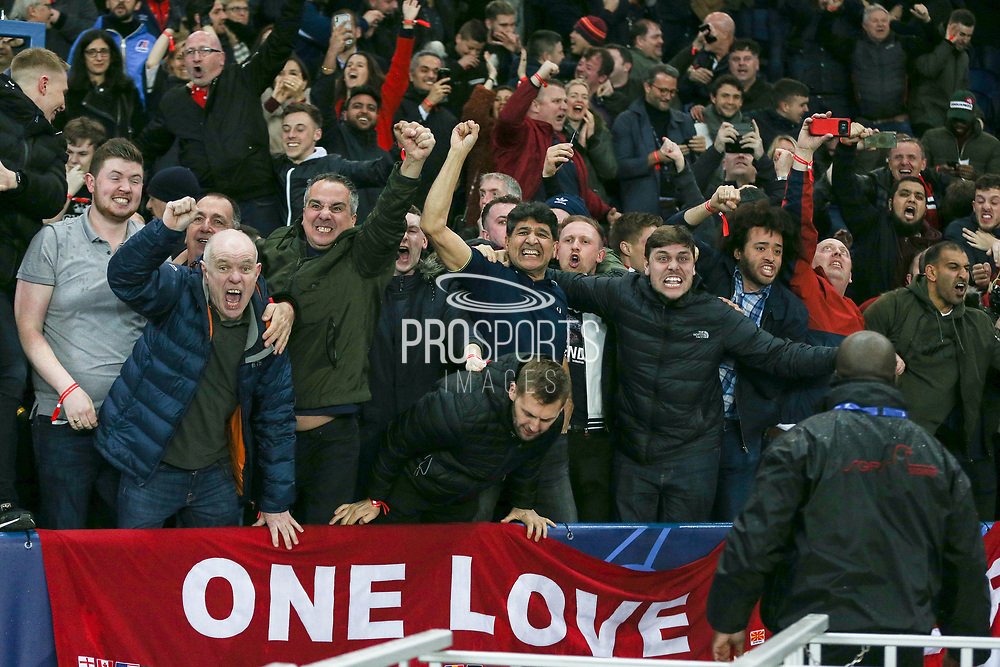 Manchester United fans celebrate during the Champions League Round of 16 2nd leg match between Paris Saint-Germain and Manchester United at Parc des Princes, Paris, France on 6 March 2019.