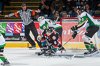 KELOWNA, CANADA - NOVEMBER 12: Jack Cowell #8 of the Kelowna Rockets gets tripped up by Ian Scott #33 of the Prince Albert Raiders in front of the net during second period on November 12, 2016 at Prospera Place in Kelowna, British Columbia, Canada.  (Photo by Marissa Baecker/Shoot the Breeze)  *** Local Caption *** Ian Scott; Jack Cowell;