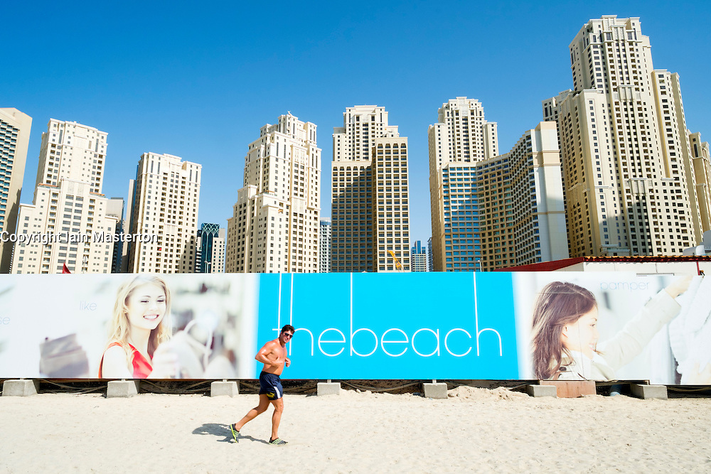 Beach and high-rise modern apartment buildings near Marina at New Dubai in United Arab Emirates