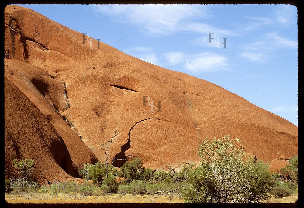 Fleas on a giant sandstone animal, tourists hike section of Ayers Rock Aborigines call mala's back Australia