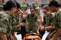 GREAT LAKES, Ill. (Aug. 6, 2018) Recruits conduct first-aid training on a simulated casualty at Recruit Training Command (RTC). The hands-on learning curriculum at RTC tests recruits on their war-fighting skills before they reach the fleet. More than 30,000 recruits graduate annually from the Navy's only boot camp. (U.S. Navy photo by Mass Communication Specialist 2nd Class Camilo Fernan)180806-N-BM202-1003