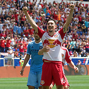 HARRISON, NEW JERSEY- JULY 24: Sacha Kljestan #16 of New York Red Bulls celebrates after beating Josh Saunders #12 of New York City FC from the penalty sport for the New York Red Bulls third goal during the New York Red Bulls Vs New York City FC MLS regular season match at Red Bull Arena, Harrison, New Jersey on July 24, 2016 in Harrison, New Jersey. (Photo by Tim Clayton/Corbis via Getty Images)