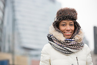 Portrait of happy woman in warm clothing outdoors