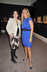 Left to right, ALEXANDRA SHULMAN and ELENA MAKRI LIBERIS at a party to celebrate the publication of Elena Makri Liberis's book 'Every Month, Same day' held at Sotheby's, 34-35 New Bond Street, London on 5th May 2009.