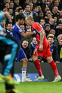 Martin Skrtel of Liverpool (right) puts his head into Diego Costa of Chelsea (left) during the Capital One Cup Semi Final 2nd Leg match between Chelsea and Liverpool at Stamford Bridge, London, England on 27 January 2015. Photo by David Horn.
