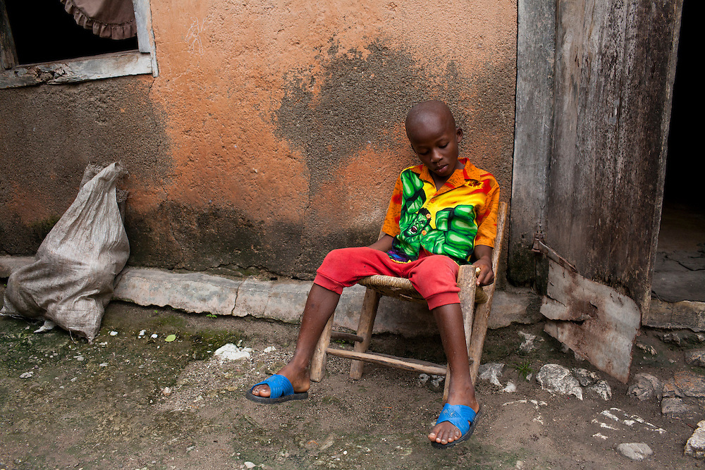 A boy sits outside his family's home on July 16, 2010 in Gador, Haiti.