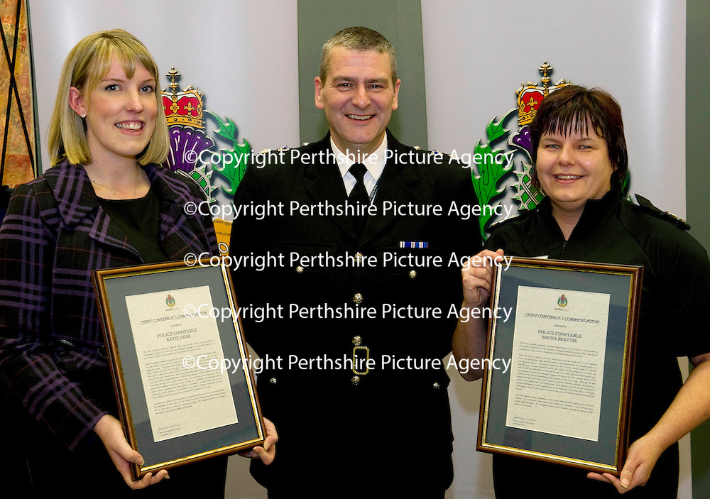 Tayside Police Chief Constable's Commendation to Constables Shona Beattie (right) and Katie Deas for the actions on Tuesday March 29th 2011 when they attended a call to a report that a man was threatening to kill himself, on arrival the agressive man was CS sprayed but still managed to stab PC Beattie in the arm, Constable Deas managed to CS spray the man a second time and he dropped the knife before picking up an axe and weilding it at her. Also pictured is Chief Supt Roddy Ross<br /> Picture by Graeme Hart.<br /> Copyright Perthshire Picture Agency<br /> Tel: 01738 623350  Mobile: 07990 594431