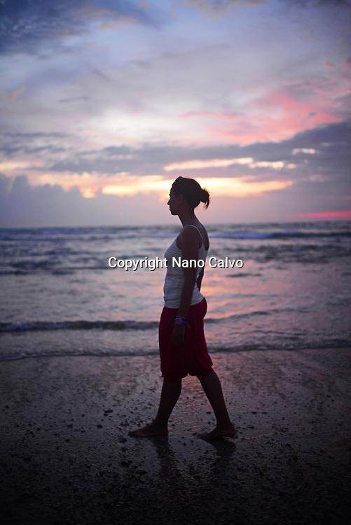 Young woman enjoying sunset at Hikkaduwa beach, Sri Lanka