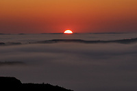 Sun rising over the fog covered Little Missouri River. Image taken with a Nikon D300 camera and 18-200 mm VR lens.