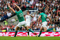 England Fly-Half George Ford kicks a Ireland Inside Centre Robbie Henshaw challenges - Mandatory byline: Rogan Thomson/JMP - 07966 386802 - 05/09/2015 - RUGBY UNION - Twickenham Stadium - London, England - England v Ireland - QBE Internationals 2015.