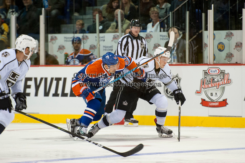 KELOWNA, CANADA - OCTOBER 2: Anton Lander #51 of the Edmonton Oilers checks a player of the Los Angeles Kings on October 2, 2016 at Kal Tire Place in Vernon, British Columbia, Canada.  (Photo by Marissa Baecker/Shoot the Breeze)  *** Local Caption *** Anton Lander;