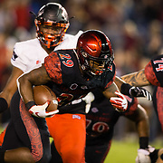 10 November 2018: San Diego State Aztecs running back Juwan Washington (29) rushes the ball for a two yard touchdown in the second quarter giving the Aztecs a 14-13 lead. The Aztecs lost 27-24 to UNLV Saturday night at SDCCU Stadium falling a game behind Fresno State in the conference standings.