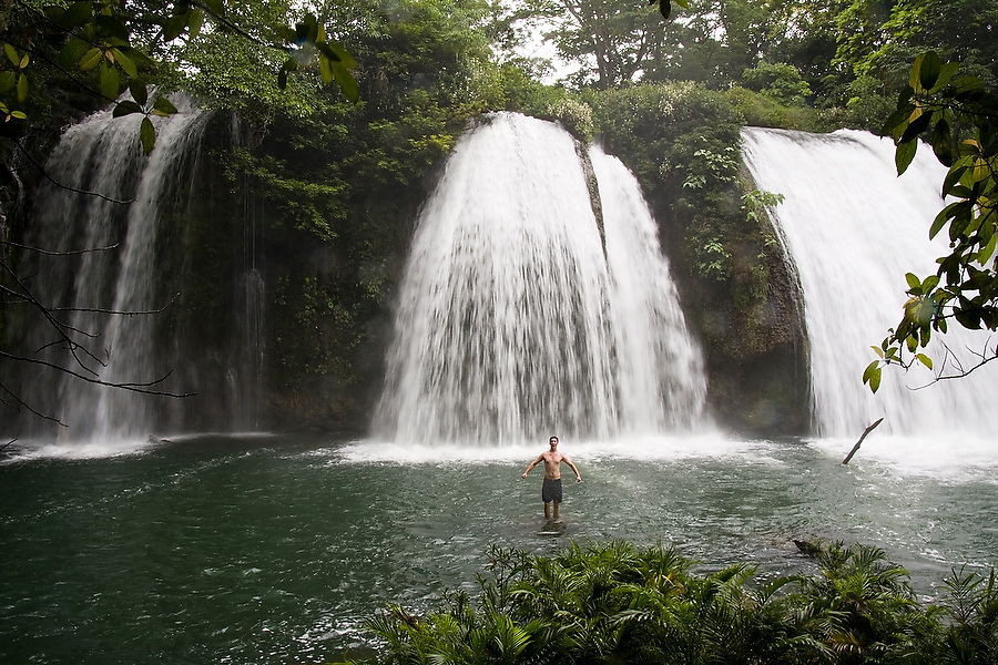 Zach Podell-Eberhadt stands proudly below the dramatic but little known Wejid-Ha Falls, just off the Palenque-Bonampak road, in Chiapas state, Mexico.