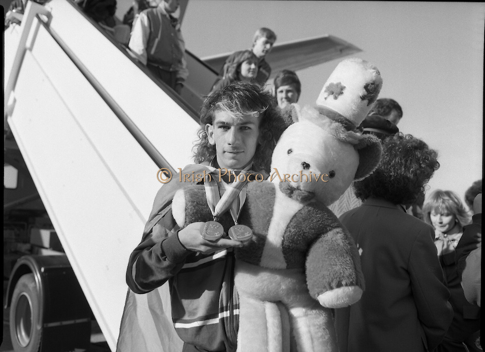 Irish Paralympic Team Arrive Home From Seoul.(R89).1988..28.10.1988..10.28.1988..28th October 1988..The Seoul Summer Paralympics 1988..The very successful Irish Paralympic team arrived home to Dublin today. The team managed a haul of 42 medals, 13 Gold, 11 Silver, 18 Bronze which earned them 19th place in the overall medal table...Proudly displaying his two Bronze medals which he won in Seoul, South Korea, Paul Leisk is pictured with his mascot 'Sag'.