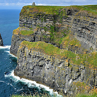 Branaunmore Sea Stack at Cliffs of Moher near Liscannor, Ireland<br /> The vertical column on the left is Branaunmore.  The sea stack was formed as relentless waves eroded the main cliff over millions of years. The majestic, isolated tower of stone stands 220 feet.  Its less formal name is O'Brien's Stack.