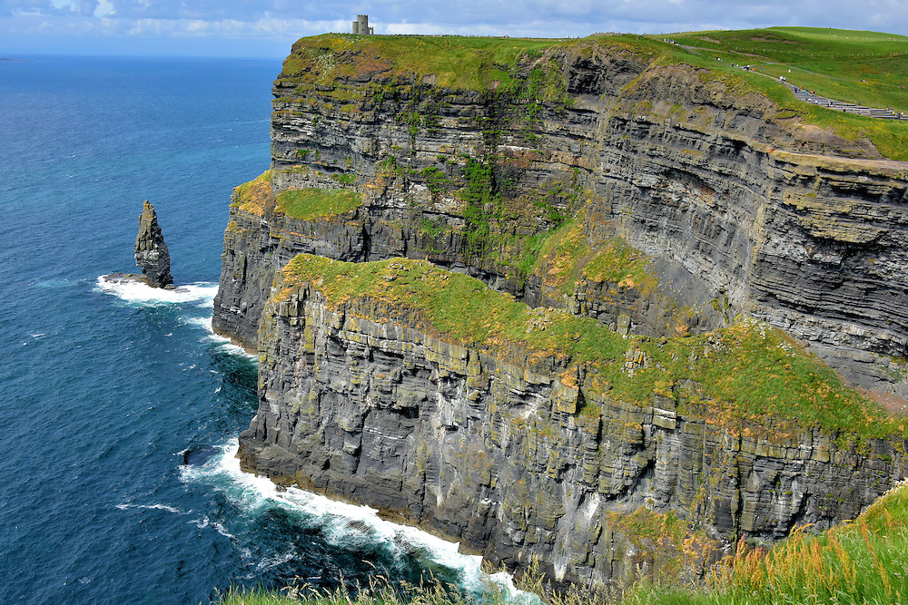 Branaunmore Sea Stack at Cliffs of Moher near Liscannor, Ireland<br /> The vertical column on the left is Branaunmore.  The sea stack was formed as relentless waves eroded the main cliff over millions of years. The majestic, isolated tower of stone stands 220 feet.  Its less formal name is O&rsquo;Brien&rsquo;s Stack.
