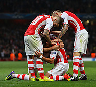 Alexis Sanchez of Arsenal (2nd right) celebrates scoring the opening goal against Besiktas J.K. with team mates during the UEFA Champions League match at the Emirates Stadium, London<br /> Picture by David Horn/Focus Images Ltd +44 7545 970036<br /> 27/08/2014