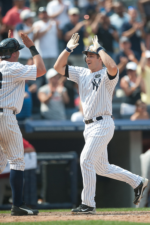 NEW YORK - JULY 21: Colin Curtis #27 of the New York Yankees is congratulated by a teammate after hitting a home run against the Los Angeles Angels at Yankee Stadium on July 21, 2010 in the Bronx borough of Manhattan. The Yankees defeated the Angels 10 to 6. (Photo by Rob Tringali) *** Local Caption ***  Colin Curtis