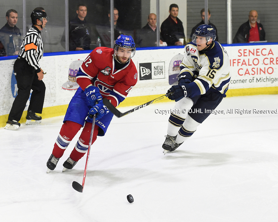 BUFFALO, NY - SEP 26,  2016: Ontario Junior Hockey League game between Toronto and Kingston, Cole Langfield #12 of the Kingston Voyageurs battles for the puck with Josh Chiarot #15 of the Toronto Patriots during the third period.<br /> (Photo by Andy Corneau / OJHL Images)