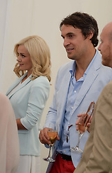 KATHERINE JENKINS and ADAM BIDWELL at the 2013 Cartier Queens Cup Polo at Guards Polo Club, Berkshire on 16th June 2013.