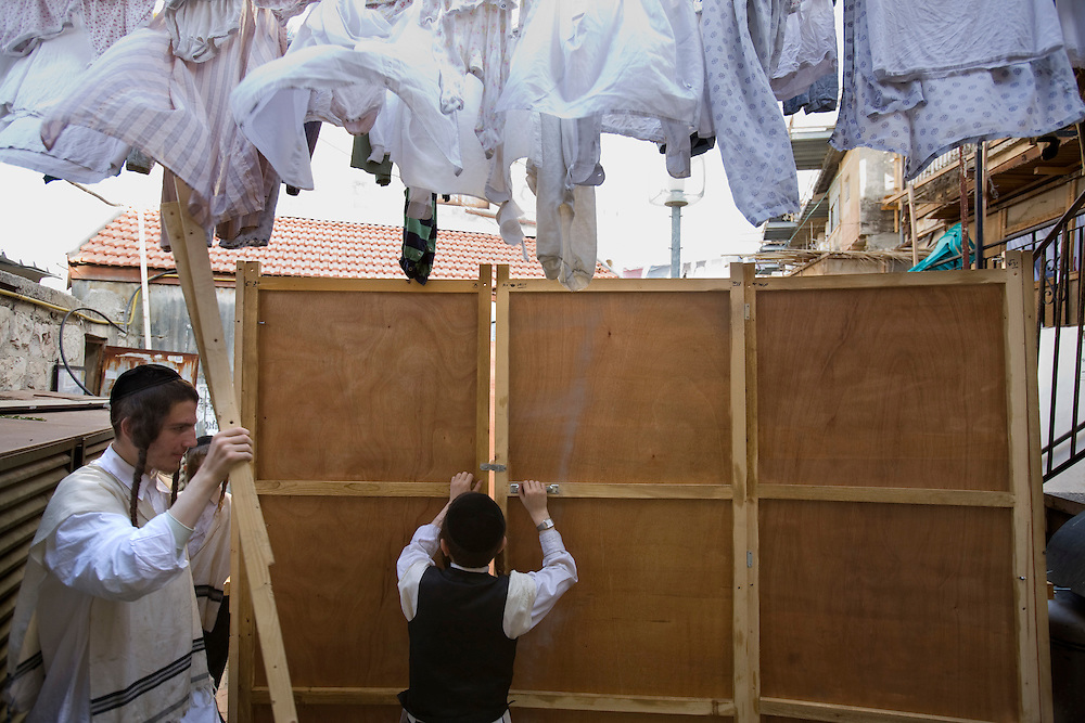 "Ultra orthodox Jewish youth build a Sukka, in the Mea Shearim ultra Orthodox neighborhood of Jerusalem, Israel,  Wednesday, Israel, Oct. 30, 2009. According to the Bible, during the Sukkot holiday, known as the Feast of the Tabernacles, Jews are commanded to bind together a palm frond, or ""lulav,"" with two other branches, along with an ""etrog,"" they make up the ""four species"" used in holiday rituals. The week long holiday begins Friday...Photo by Olivier Fitoussi /ABACAUSA.COM"