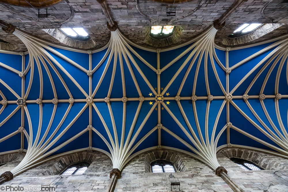 """Vaulted blue ceiling of St Giles' Cathedral (High Kirk of Edinburgh), the principal place of worship of the Church of Scotland in Edinburgh. Its distinctive crown steeple is a prominent feature of the city skyline, at about a third of the way down the Royal Mile. The church has been one of Edinburgh's religious focal points for approximately 900 years. The present church dates from the late 1300s, though it was extensively restored in the 1800s. Today it is sometimes regarded as the """"Mother Church of Presbyterianism."""" The cathedral is dedicated to Saint Giles, who is the patron saint of Edinburgh, as well as of cripples and lepers, and was a very popular saint in the Middle Ages. Edinburgh is the capital city of Scotland, in Lothian on the Firth of Forth's southern shore, Scotland, United Kingdom, Europe."""