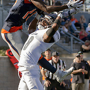 Orange Coast College wide receiver James Rutledge rises up over Fullerton College's Tim Gordon in the second half of Fullerton's 35-14 win on November 5, 2016.