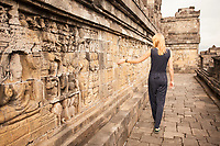 A model glides through the ancient temple of Borobudur, Indonesia.