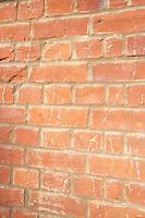Close-up of reddish-brown brick wall