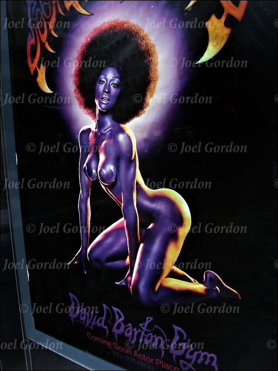 Sex is everywhere in the American Culture today. advertising billboard in which sex is used to sell a product. Semi nude of African American female with  60's Afro used to prom new opening of David Barton Gym