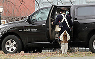 Newburgh, New York  - A Revolutionary War reenactor in uniform stops by his truck at Washington's Headquarters State Historic Site during the George Washington's birthday celebration on Feb. 18, 2012.