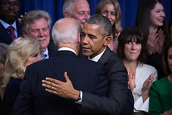 December 13, 2016 - Washington, DC, United States - President Barack Obama hugs VP Joe Biden, after signing the 21st Century Cures Act, in the South Court Auditorium of the Eisenhower Executive Office Building of the White House in Washington, DC. on December 13, 2016. The legislation eases the development and approval of experimental treatments and reforms federal policy on mental health care. (Credit Image: © Cheriss May/NurPhoto via ZUMA Press)