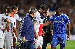 PSG Defender Thiago Silva (BRA) is helped off by Chelsea Forward Samuel Eto'o (CMR) - Photo mandatory by-line: Rogan Thomson/JMP - 07966 386802 - 08/04/2014 - SPORT - FOOTBALL - Stamford Bridge, London - Chelsea v Paris Saint-Germain - UEFA Champions League Quarter-Final Second Leg.