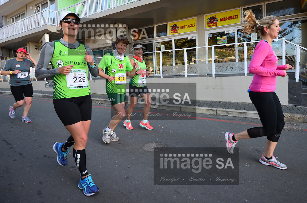 MOSSEL BAY, SOUTH AFRICA - SEPTEMBER 24: runners run through the picturesque town on the 10km route during the PetroSA Marathon finishing at Santos Caravan Park on September 24, 2016 in Mossel Bay, South Africa. (Photo by Roger Sedres/Gallo Images)