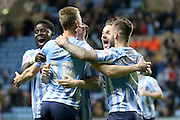 Coventry midfielder Andy Rosegets congratulations after scoring during the Sky Bet League 1 match between Coventry City and Bradford City at the Ricoh Arena, Coventry, England on 19 April 2016. Photo by Chris Wynne.