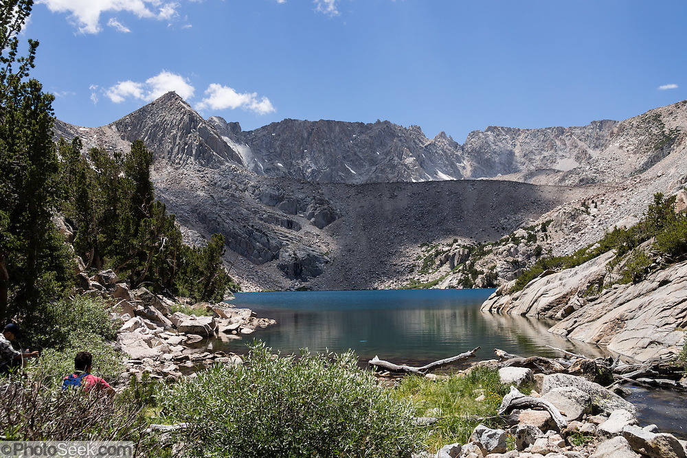 Upper Lamarck Lake in John Muir Wilderness, Inyo National Forest, Sierra Nevada, California, USA. In the Bishop Creek watershed, enjoy a scenic hike from North Lake to Lamarck Lakes. The moderate trail to Upper Lamarck Lake is 5.5 miles round trip with 1550 feet cumulative gain.