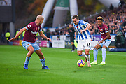 Chris Lowe of Huddersfield Town (15) looks to take on Pablo Zabaleta of West Ham United (5) during the Premier League match between Huddersfield Town and West Ham United at the John Smiths Stadium, Huddersfield, England on 10 November 2018.