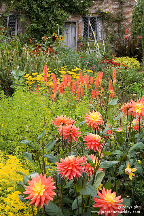 Hot colours in the Cottage Garden at Sissinghurst Castle. Dahlia 'Brandaris', Kniphofia 'David' and Achillea 'Coronation Gold'
