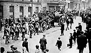 Railway Strike, Britain, 1911.  Soldiers in Sheffield escorting coal carts during the strike.