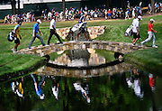 Jul 29, 2016; Springfield, NJ, USA; The group of Jordan Spieth, Bubba Watson and Sergio Garcia cross over the bridge on the 18th hole during the second round of the 2016 PGA Championship golf tournament at Baltusrol GC - Lower Course. Mandatory Credit: Eric Sucar-USA TODAY Sports