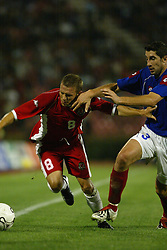 BELGRADE, SERBIA & MONTENEGRO - Wednesday, August 20, 2003: Wales' Craig Bellamy is tackled by Serbia & Montenegro's Ivica Dragutinovic during the UEFA European Championship qualifying match at the Red Star Stadium. (Pic by David Rawcliffe/Propaganda)
