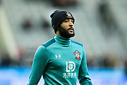 Nathan Redmond (#22) of Southampton warms up ahead of the Premier League match between Newcastle United and Southampton at St. James's Park, Newcastle, England on 8 December 2019.