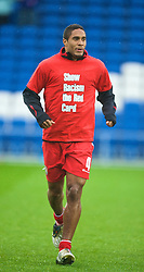 CARDIFF, WALES - Saturday, November 14, 2009: Wales' Ashley Williams warms-up wearing a 'Show Racism the Red Card' shirt before the international friendly match against Scotland at the Cardiff City Stadium. (Pic by David Rawcliffe/Propaganda)