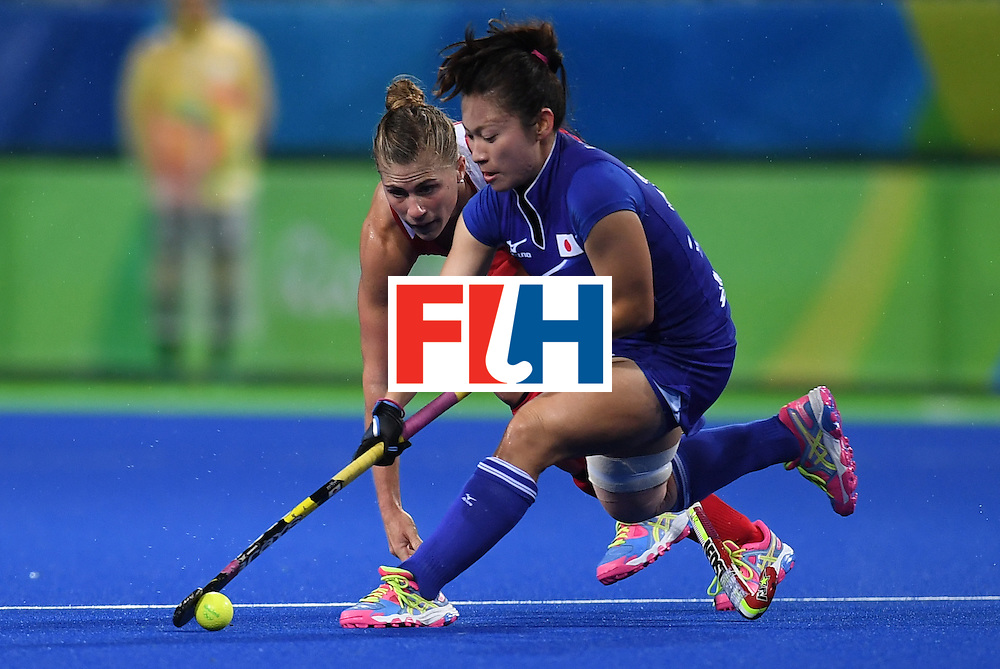 The USA's Katelyn Falgowski (L) vies for the ball with Japan's Hazuki Nagai during the women's field hockey USA vs Japan match of the Rio 2016 Olympics Games at the Olympic Hockey Centre in Rio de Janeiro on August, 10 2016. / AFP / MANAN VATSYAYANA        (Photo credit should read MANAN VATSYAYANA/AFP/Getty Images)