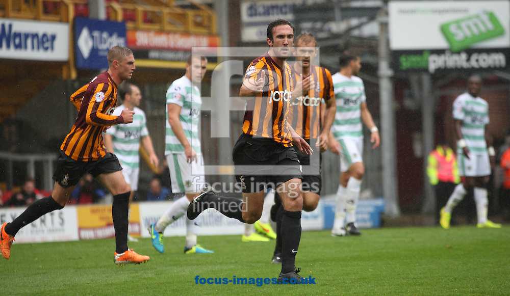 Rory McArdle of Bradford City celebrates scoring the goal against Yeovil Town during the Sky Bet League 1 match at the Coral Windows Stadium, Bradford<br /> Picture by Stephen Gaunt/Focus Images Ltd +447904 833202<br /> 06/09/2014