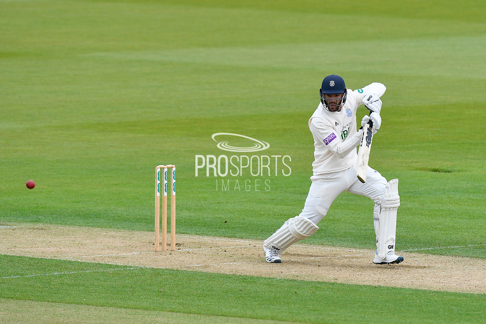 Aiden Markram of Hampshire hits the ball to the boundary for four runs during the first day of the Specsavers County Champ Div 1 match between Hampshire County Cricket Club and Essex County Cricket Club at the Ageas Bowl, Southampton, United Kingdom on 5 April 2019.
